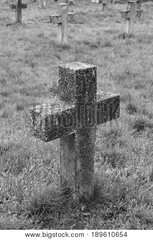 Old cross in the military cemetery. Black And White.