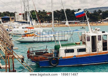 Yachts with sails at the berth port facilities infrastructure concept