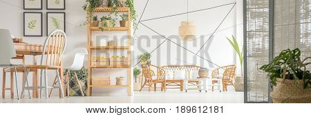 Wooden decor in white spacious living room and dining hall