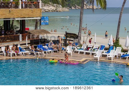 KOH PHANGAN THAILAND - DECEMBER 14 2016: Haad Rin beach before the full moon party. Unidentified people arrived on the island of Koh Phangan to participate in the Full Moon party