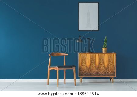 Intensive blue wall and vintage designer chair