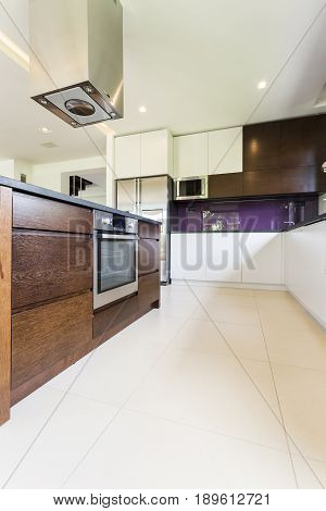 Modern and functional kitchen with built-up oven fridge and white cupboards