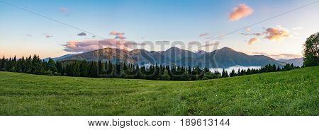 Panorama Of Beautiful Dawn With Mountains Ridge
