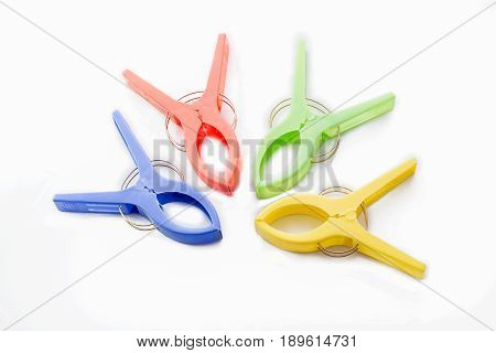Many cloth clamps isolated.clamps on white background.