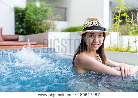 Woman enjoy jacuzzi spa
