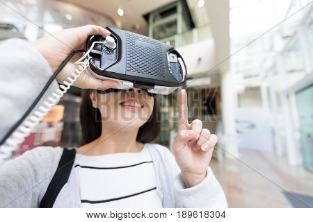 Woman reading on virtual reality device