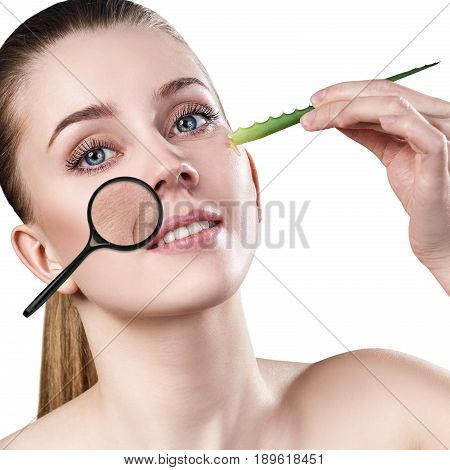 Woman with magnifying glass shows age-related mimic wrincles on her face.. poster