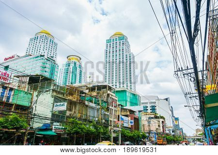 Bangkok Thailand - June 3 2017: The Berkeley Hotel Pratunam with old business buildings in the foreground and a cloudy background seen from Rajaprarop Road in Bangkok Thailand.