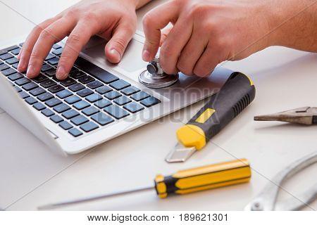 Computer repairman repairing computer laptop