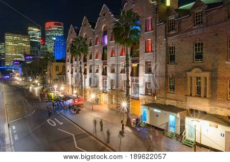 Sydney Australia - May 27: Street in The Rocks neighbourhood with Sydney CBD skyscrapers on Vivid Sydney festival