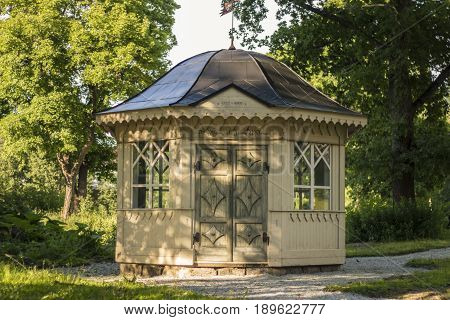 Old Gazebo in a summer park on a hot day.