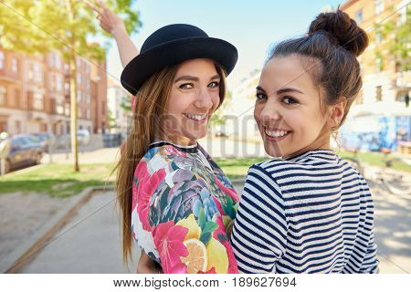 Two Pretty Women With Lovely Cute Smiles