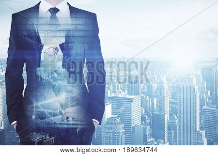 Businessman on toned city background with handshake and forex chart. Deal concept. Double exposure
