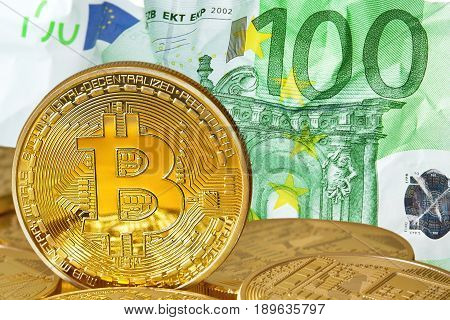 Golden Bitcoins close-up.Background euro currency. Photo (new virtual money ) .Conceptual photo.