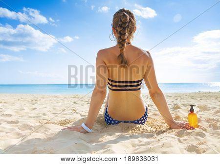 Healthy Woman In Swimsuit On Seashore Sunbathing