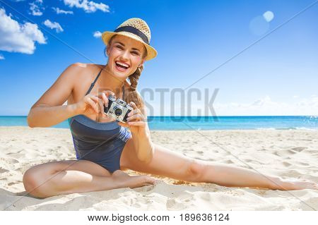 Happy Active Woman On Seacoast Taking Photo With Digital Camera