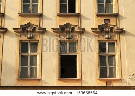 front of and old yellow house with windows, Olomouc, Czech Republic