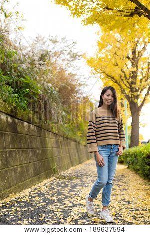 Asian Woman with yellow Gingko tree