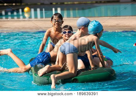 School Children Have Fun In A Swimming Pool During A Swimming Lesson.