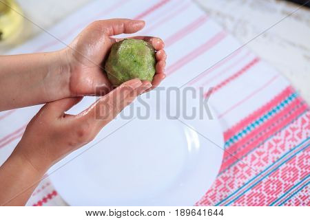 Crude Forcemeat Cutlet With A Stuffing In A Hand On A Light Background