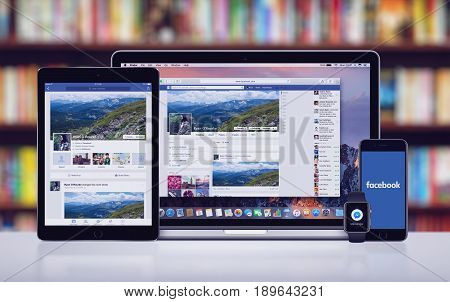 Varna, Bulgaria - May 23, 2017: Facebook on the Apple MacBook Pro, Facebook app on iPad Pro, splash screen logo on iPhone 7 and Facebook Messenger notification icon on Apple Watch. Office desk concept