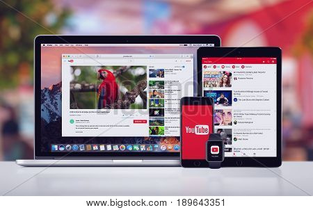 Varna, Bulgaria - May 23, 2017: YouTube on the Apple MacBook Pro, YouTube app on iPad Pro and splash screen logo on iPhone 7 and YouTube notification icon on Apple Watch. Office desk concept.