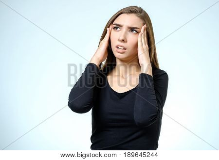 Portrait Of Depressed Woman Touching Her Head