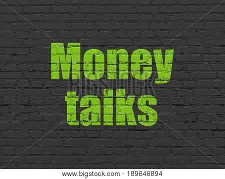 Business concept: Painted green text Money Talks on Black Brick wall background