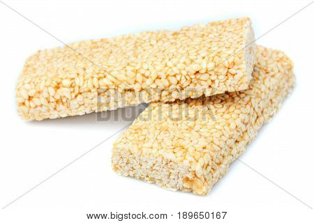 Two pieces of gozinaki confection sweets isolated on white background.