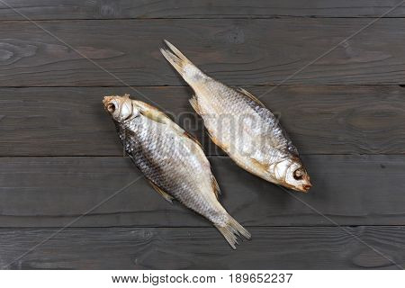 Dried fish on the table. Salty dry river fish on a dark wooden background.top view with copy space