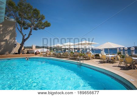 CALA FORNELLS MALLORCA SPAIN - SEPTEMBER 6 2016: Pool at The Grand Tortuga restaurant with ocean view on a sunny day on September 6 2016 in Cala Fornells Mallorca Spain.