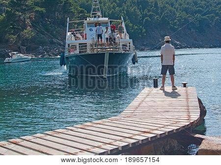 Ferry Arrival And Waiting Tourists