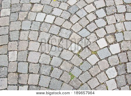 Cobble stone road surface texture for background copy space.