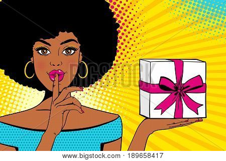 Wow Pop Art Face. Young Sexy Surprised African American Woman With Open Mouth Holding Bright Gift Bo