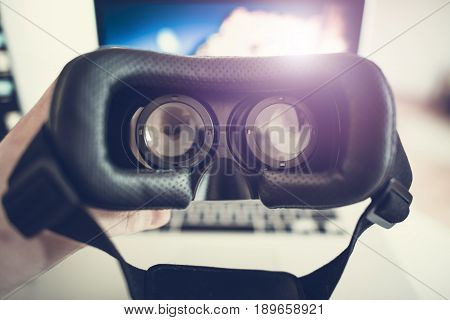 Virtual Reality 3D Goggles For Watching 360 Degrees 3D 60fps Video. Future of Virtual Reality Concept Photo. Wearing Goggles.