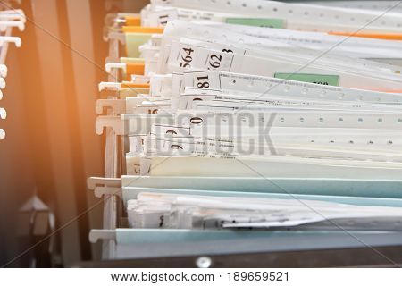 file folders with personal finance documents in cabinet.