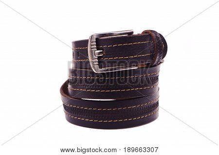 Belt male leather.The fashionable accessory is twisted on a white background.With a metal buckle.Natural animal skin.