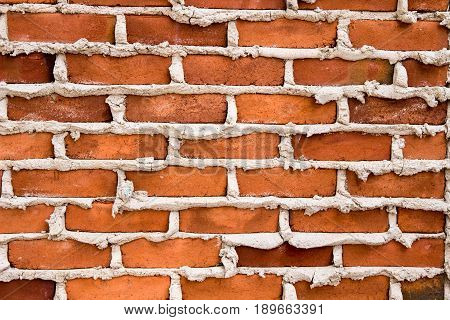 Brick And Mortar Background. Red brick wall with fresh mortar background.