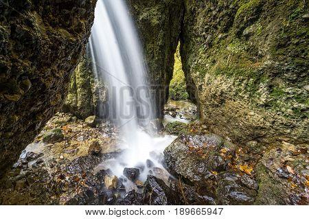 Beautiful waterfall in a narrow gorge. Allgau Alps.