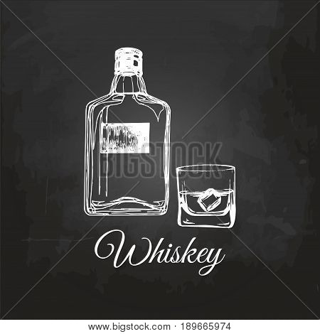Hand sketched whiskey bottle and glass. Vector illustration of scotch set. Vintage alcoholic drink menu design concept on chalkboard for bar, restaurant etc.