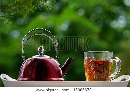 Tea time teapot tea glass cup of tea