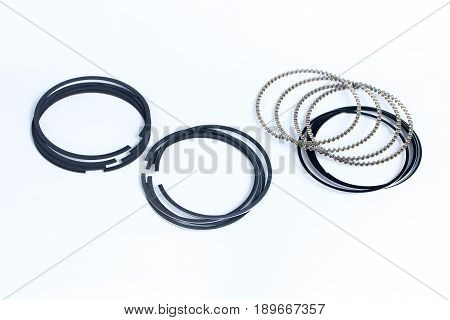 Spare parts for car piston rings on white isolated. New original equipment spare parts