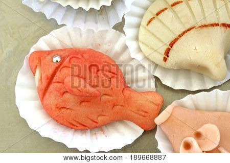 Marzipan made to look like a fish and a seashell.