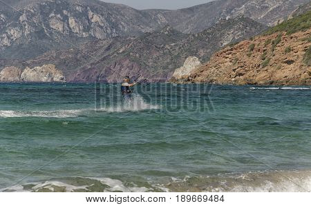 Porto Paglia Italy - October 03 2016: Senior person keeps active by practicing extreme sport