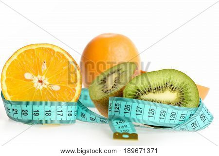 Halves Of Orange And Kiwi Fruit On Blue Sewing Centimeter