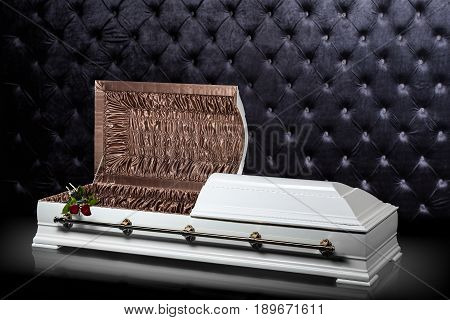 Opened wooden white sarcophagus isolated on gray luxury background. casket, coffin on royalbackground. Ritual objects for burial. Conduct of the deceased on his last journey. Surrender body dust of the earth. Christian funeral ritual