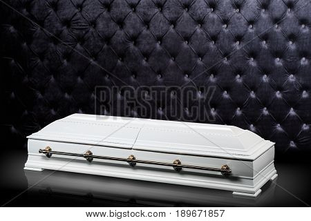 closed wooden white coffin isolated on gray luxury background. casket, sarcophagus on royalbackground. Ritual objects for burial. Conduct of the deceased on his last journey. Surrender body dust of the earth. Christian funeral ritual