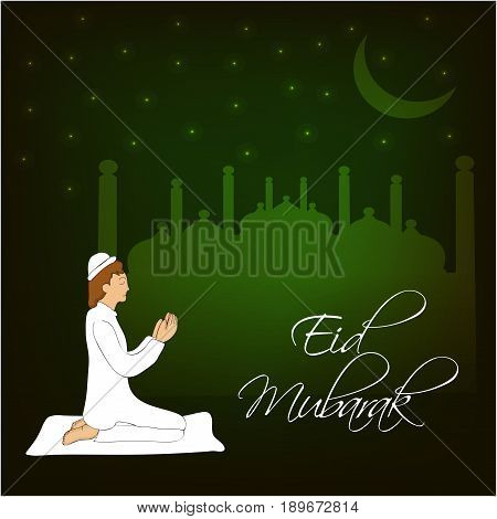 illustration of a man praying on the occasion of muslim festival Eid and eid mubarak text