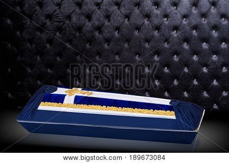 closed coffin covered with blue and white cloth decorated with Church gold cross isolated on gray luxury background. Ritual objects for burial. Surrender body dust of the earth. Christian funeral ritual