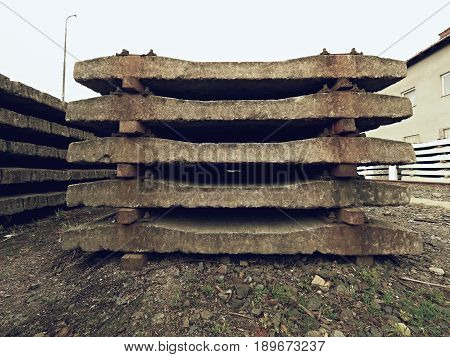 Extracted Old Concrete Sleepers In Stock. Old  Rusty Used Concrete Railway Ties Stored